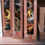 Plastic jungle animals packaged in a box labelled 'boys stuff'