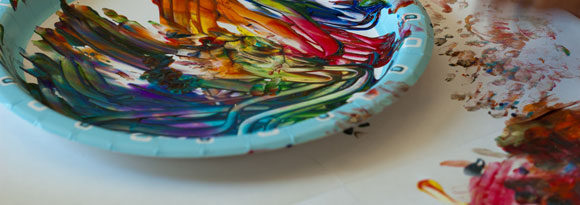 Plate with paints and finger painting Photo by Mark Baylor